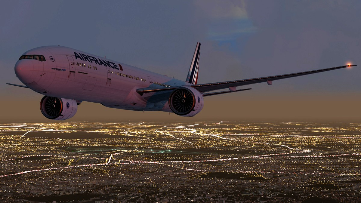 B777 over Paris lights