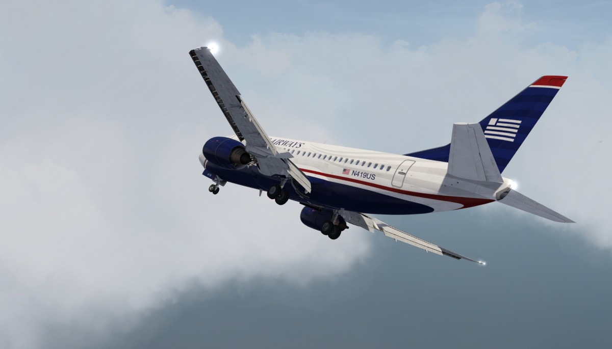 B737 base to final, racing through the clouds