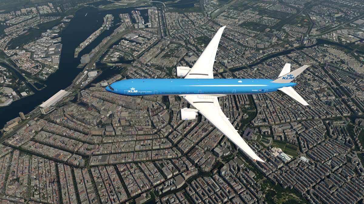 B777 just over the city of Amsterdam