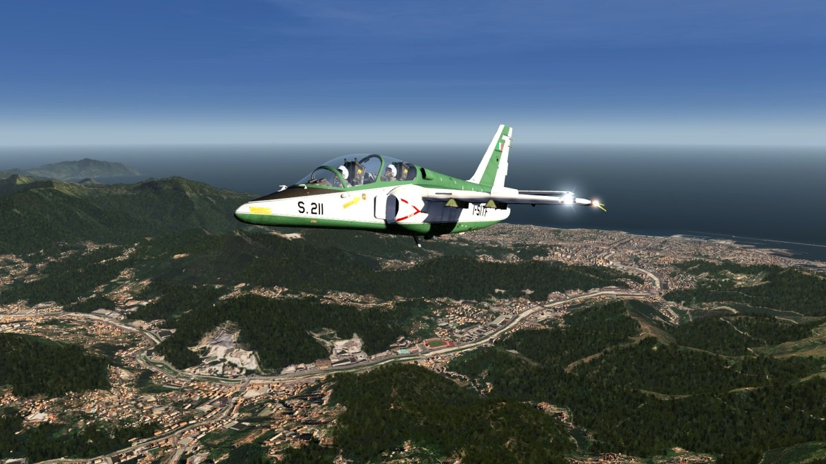 BELLA ITALIA - In the background, the city of Genoa ''SIAI Marchetti S-211''